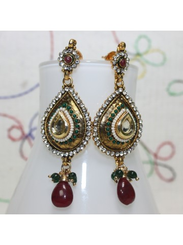 https://static8.cilory.com/16007-thickbox_default/ellegant-polki-work-earrings-carved-with-stone-and-beads.jpg